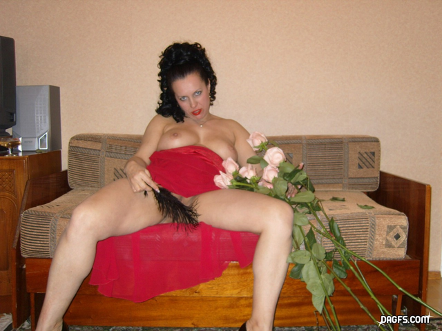busty mom jessica caresses her pussy with feather under her red dress
